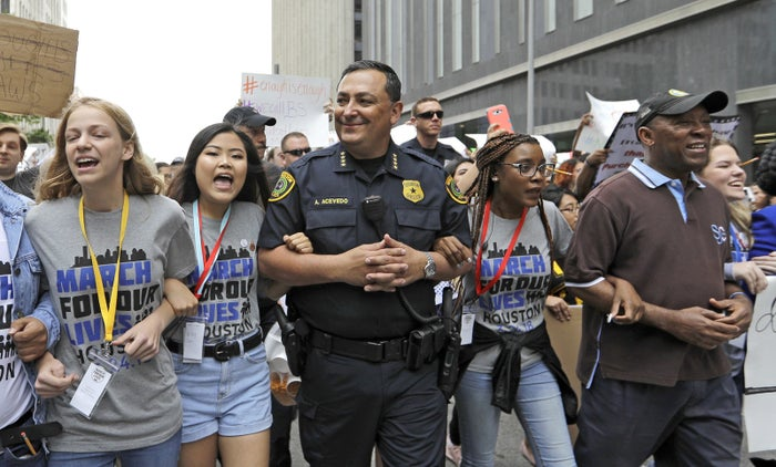 "Houston Police Chief Art Acevedo, center, during a ""March for Our Lives"" protest for gun legislation and school safety on March 24 in Houston."