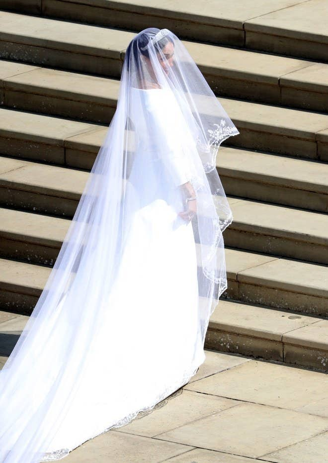 Her Royal Highness chose French fashion house Givenchy to design her wedding gown. A custom Haute Couture creation from Clare Waight Keller (who is British), this was a major first victory for the first female creative director at Givenchy. The simplicity of the dress is perhaps what's most exciting about it. The shape – sculptural in nature, was made of double-bonded silk cady with 6 sublime seams cascading down the dress. Keller also designed the bridesmaid dresses and wedding shoes – made of silk duchesse satin.