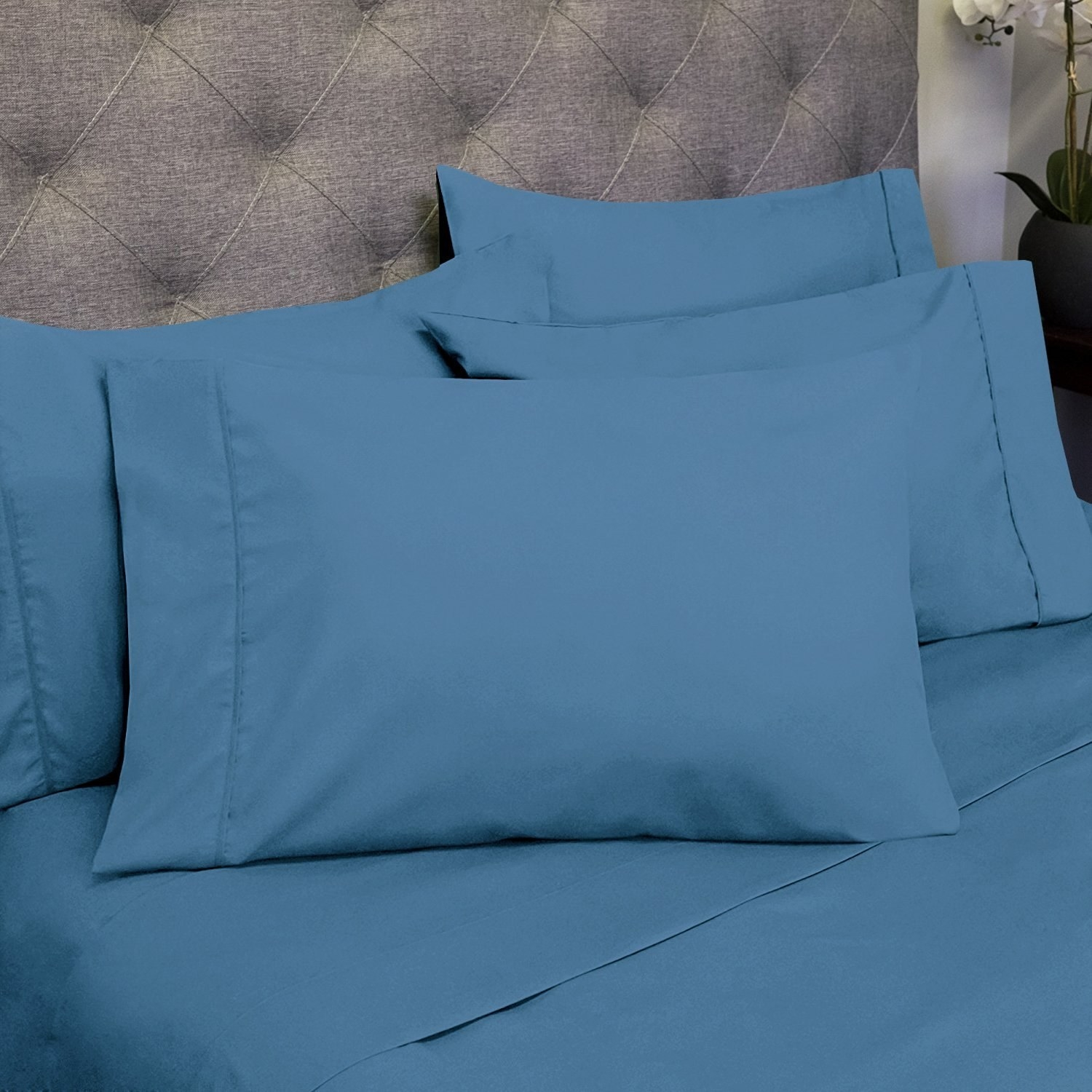 "The set includes a flat sheet, a fitted sheet and either two or four pillow cases depending on which size you choose. Promising review: ""There are times when you come across an item on Amazon and the price just shocks you to the point that you wade through 16 pages of reviews just because it feels like a trick. That's how I came across these in my never ending search for the perfect set of sheets. I have to tell you, I was way skeptical. Not that a thousand people could all be deluded and tricked me into buying something that turned out to be garbage, but because all sheets are not the same and what those thousand people love, I could very well hate and just not get what there is to love about them. I have to admit, though, I am impressed. These sheets are well made and no matter how many times I have washed them, they still come out of the dryer looking like they were just ironed. I've had no problems with pilling or fading. They fit our king size bed wonderfully and the color is stunning. I would not hesitate to buy more in the future."" —CBPrice: $24+ (available in 39 colors and six sizes)"
