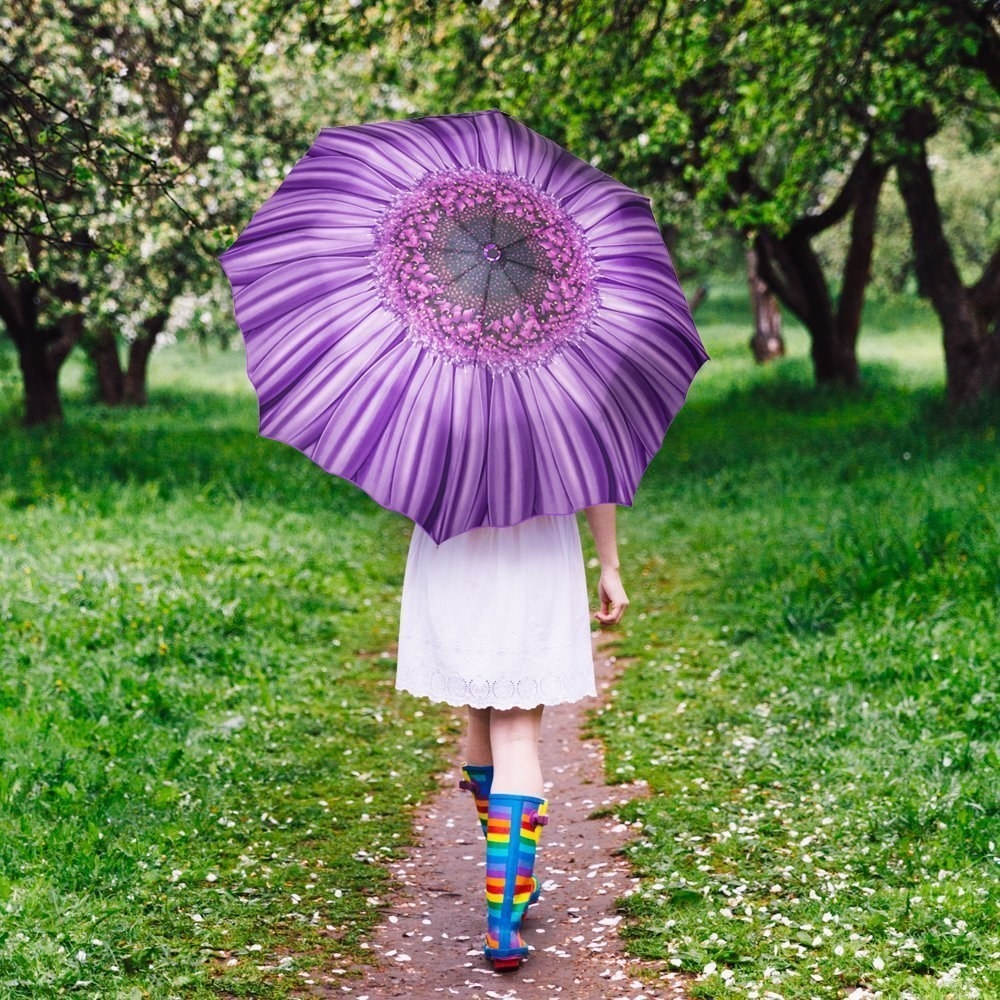 "Promising review: ""Gorgeous umbrella. I bought for a trip to the south of France. When I ordered it, I figured that if it didn't suit me then it would be just perfect to gift to one of my nieces! Well, the little ones missed out on this because I absolutely fell in love with this beautiful purple umbrella! I still think it would make a wonderful gift! The beauty of this umbrella is for all ages, a good sturdy design, tasteful colors and details, and just so uniquely perfect! The umbrella not only opens with a button but it also closes with the same button! Once it closes automatically with the push of a button, it will require a good push to lock it down back to a compact shape. I packed this umbrella in my checked bag both ways. There were a total of four flights and it held up perfectly. My only problem now: I totally want one of these gorgeous flower umbrellas in every color!"" —Globetrotter333Price: $14.88 (available in four colors)"