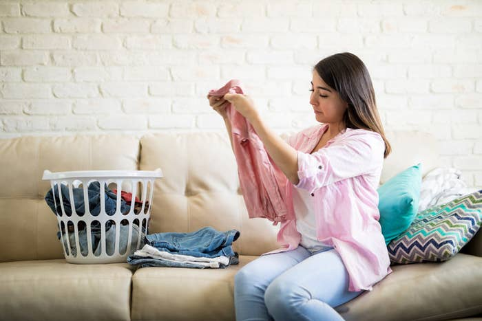 Aside from undergarments, stained items, and questionably smelly things, most clothes can be worn at least a few times before washing. If you notice a stain, try spot-treating or hand-washing it lightly. Constant washing wears down the fabrics (affecting the stretch in them) and fades the color in your clothes, making them look worn out.