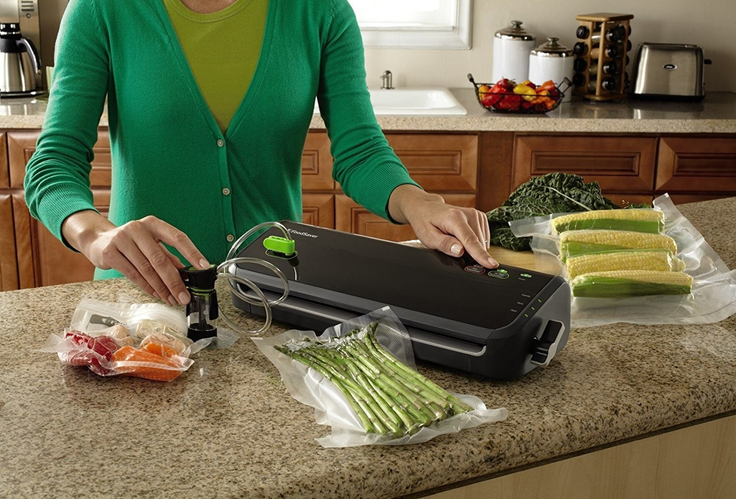 "Set Includes 3-quart bags, 2-gallon bags, one 11"" x 10"" roll, vacuum, and accessory hose. Keeps food fresh for up to five times longer and prevents freezer burn. Be sure to allow your food to reach room temperature before vacuum sealing it. Some foods that can't be vacuum sealed include: soft cheeses, raw bananas or mushrooms, whole apples, and certain other raw vegetables. Find a full list and more FAQs regarding the FoodSaver vacuum sealer here. Check out our post on the shelf life of different foods here.Promising review: ""I've had three different models of the FoodSaver over the past 10 years, and this is the best yet. It's lightweight, easy to use, great seal, smaller shelf/counter footprint, and the cord wraps inside the bottom of the case. The cord is under three feet long, so you do have to have space on the counter close to an outlet to use this. It does well with all the freezer bags I've used, and with the suction tube for canisters and the refrigerator bags."" —BillPrice: $69.99. Get extra bags for $18.45."