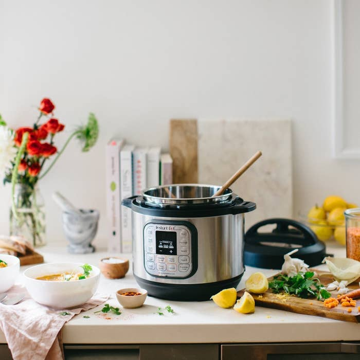 """It's a pressure cooker, slow cooker, rice cooker, steamer, sauté pan, yogurt maker, and food warmer all rolled into one snazzy appliance. (Check out our full review of the Instant Pot!)Promising review: """"I absolutely despise spending a lot of time in the kitchen after work. I am tired, just want to pour a glass of wine, and binge-watch Supernatural. My boyfriend can't cook to save his life, so that isn't much help either. I'd feel better eating something created out of real, edible foods rather than microwaved in a pouch with fake cheese, so I cook even when I stay over at his house. Just when I was pondering the option of breaking up and finding a man who can cook (not really), INSTANT POT HAPPENED! Dinner is done and ready to eat every time in less than an hour. Sometimes WAY less than an hour. I can't believe I survived 30 years without one! It would have been AMAZING back when I was in college! I am constantly learning new things I can whip up (sometimes trial and error, sometimes recipe books). I can throw frozen chicken breasts in it, seasoning, just hit poultry setting, adjust the time up a bit, and boom. Super tender amazing chicken. Something about handling raw chicken makes me too disgusted to eat it once it's cooked, so being able to throw it in frozen is such a relief."""" —SunahmGet it from Amazon for $69.95+ (available in 6- and 8-quart)."""