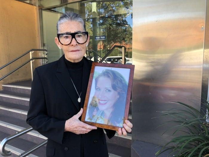 Caroline Watson-Ley holds a picture of Naomi outside the NSW Coroner's Court.