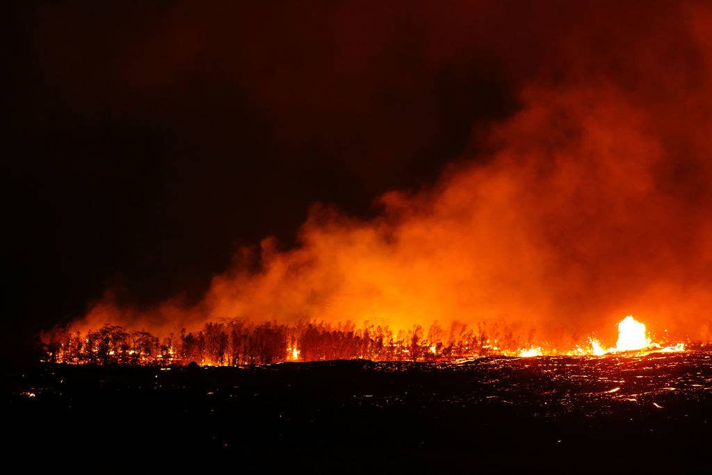 The lava flowed through state forest reserve lands, burning hundreds of trees.