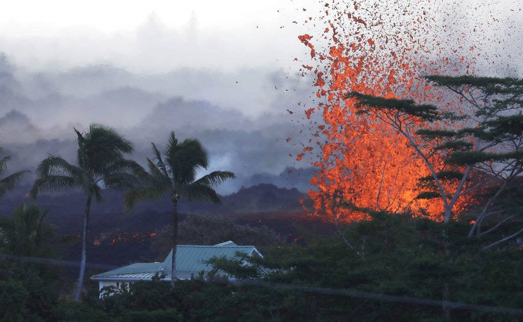 Lava is seen erupting near a home at dawn on Hawaii's Big Island on May 18.