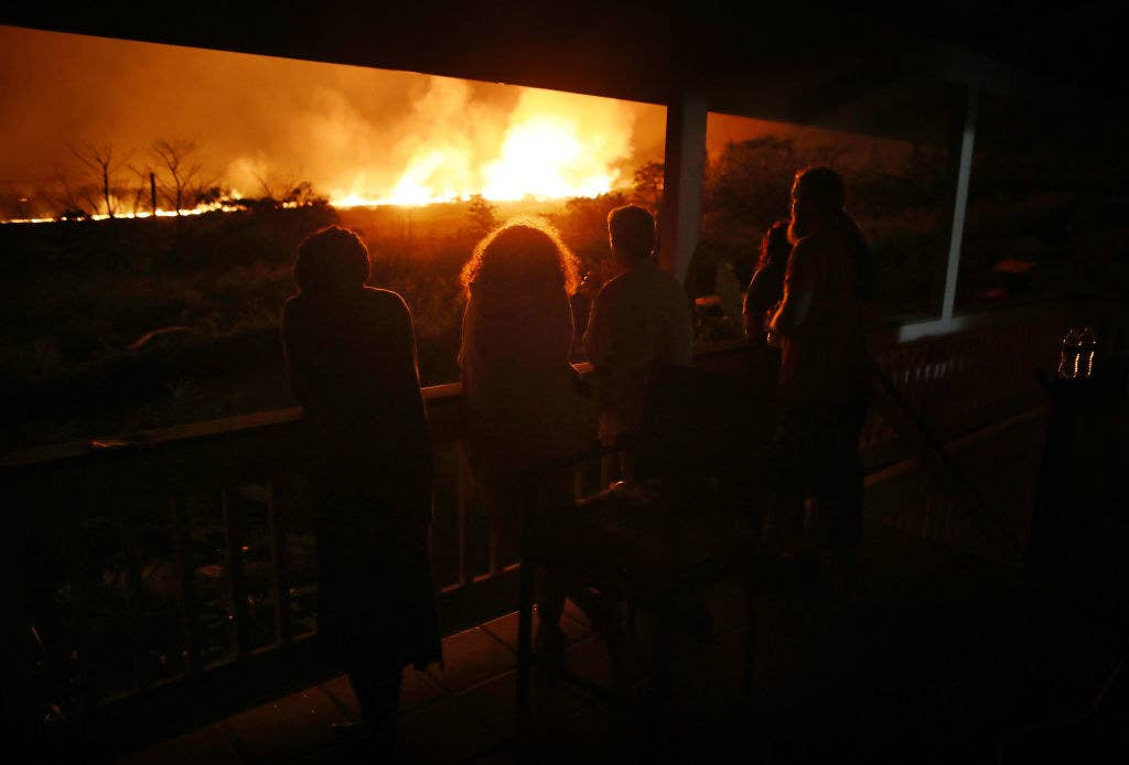 Residents watch lava erupting at a small viewing party on someone's porch Saturday night.