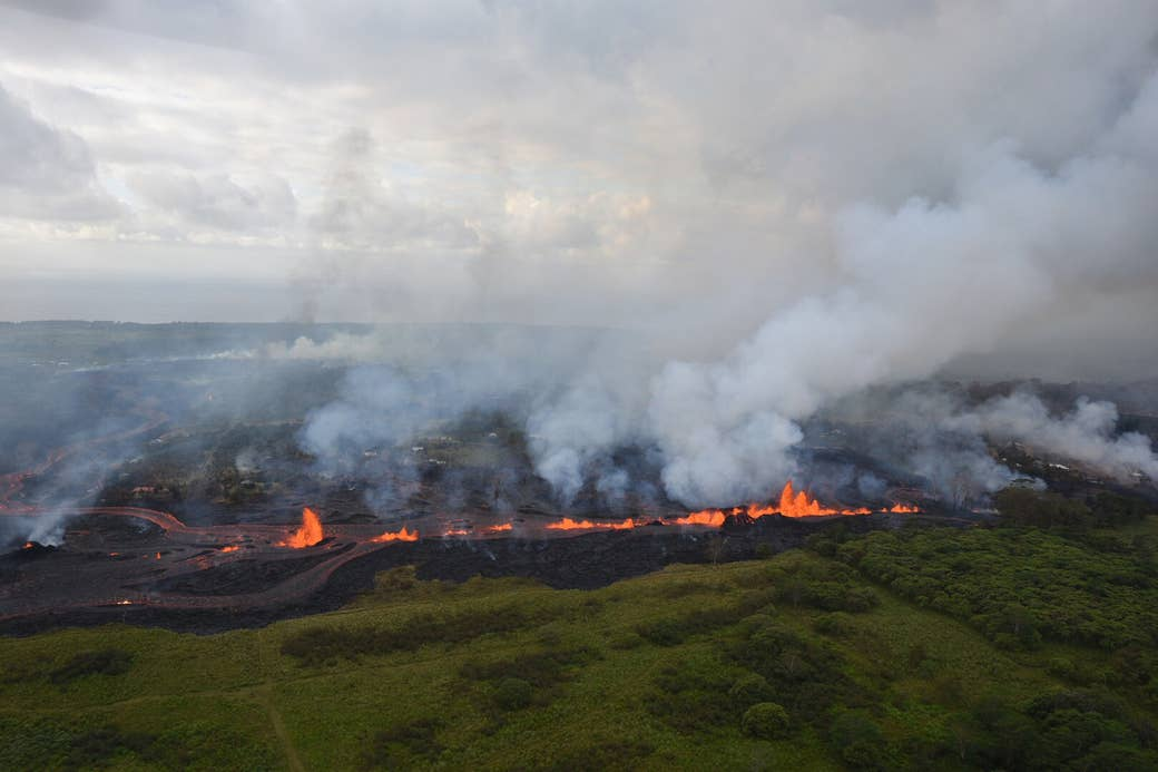 This aerial photo taken Saturday shows fissures spewing lava into the air. Because of the recent eruptions, residents have been warned of increased sulfur dioxide levels and are urged to take action to limit exposure.