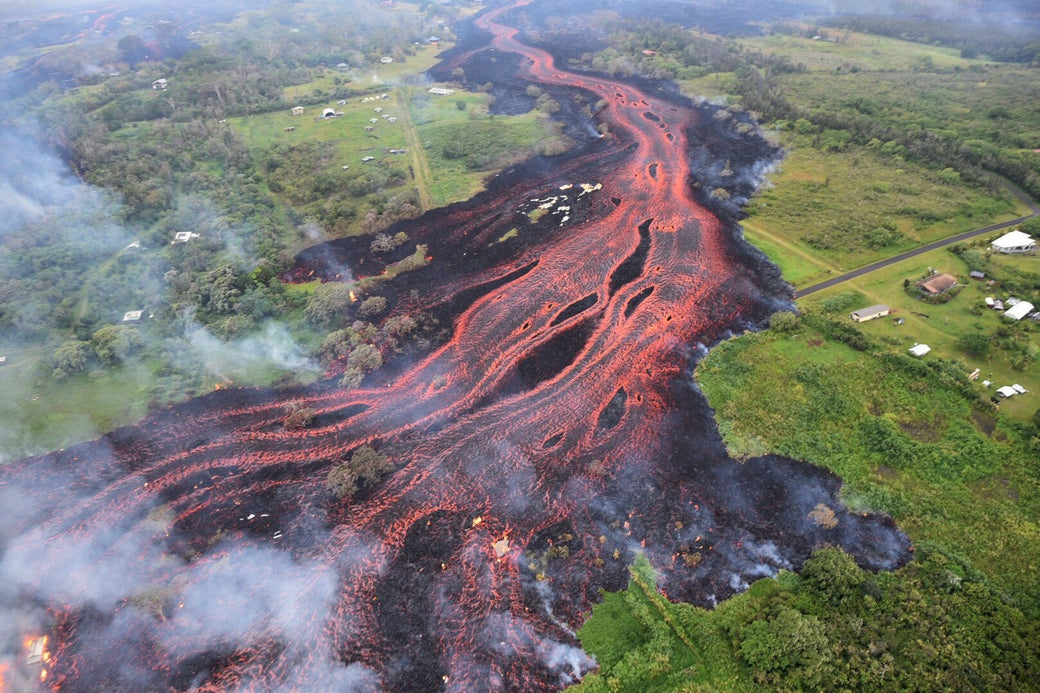 Photos from a helicopter overflight of Kilauea's lower East Rift Zone Saturday shows lava flows emerging and moving downslope.