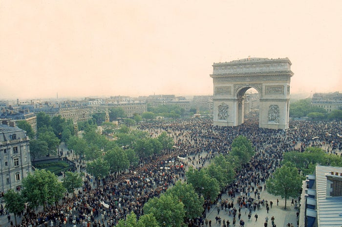 Student and workers march toward the Arc de Triomphe to demand changes ranging from government policy to job security on May 24.