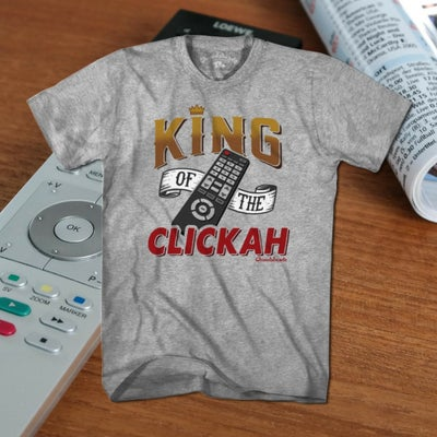 You rule over the remote. You're in charge of the changer. You're the King of the Clickah! If no one in the house gets to watch what they want while you're in your throne (recliner), then grab this tee and claim your title. Perfect for dad, or any television tyrant in your life.