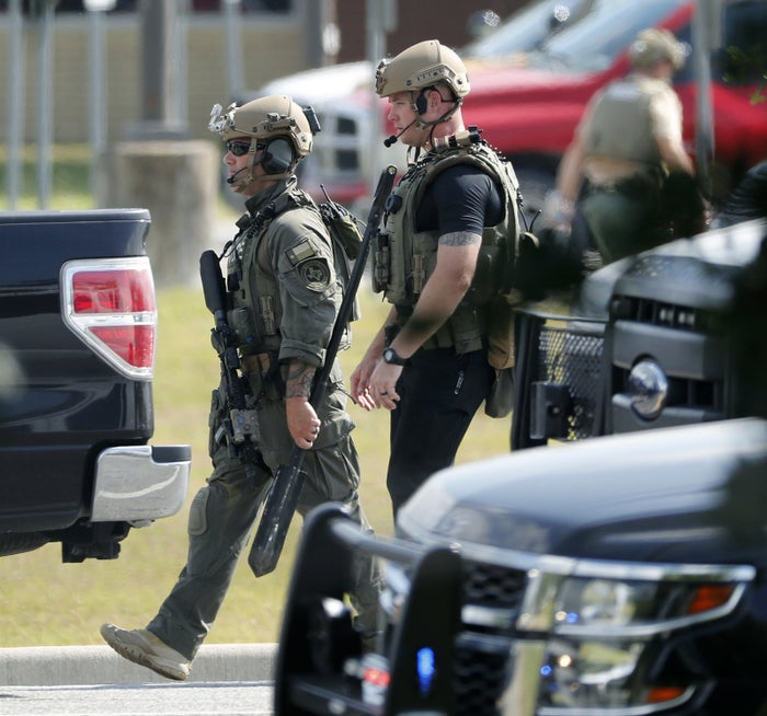 Police officers respond in tactical gear after the shooting at Santa Fe High School.