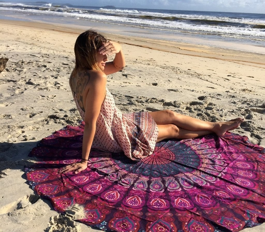 "Promising review: ""The is absolutely beautiful! I used this as a beach blanket and made the mistake of not washing first, so when we laid on the blanket we had the design tattooed on us, haha, but it washed right off when we got in the water. So definitely wash by itself before using."" —Amber Dowell Get it from Amazon for $12.99 (originally $29.99)."