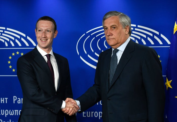 European Parliament President Antonio Tajani (right) welcomes Facebook CEO Mark Zuckerberg at the European Parliament on Tuesday.