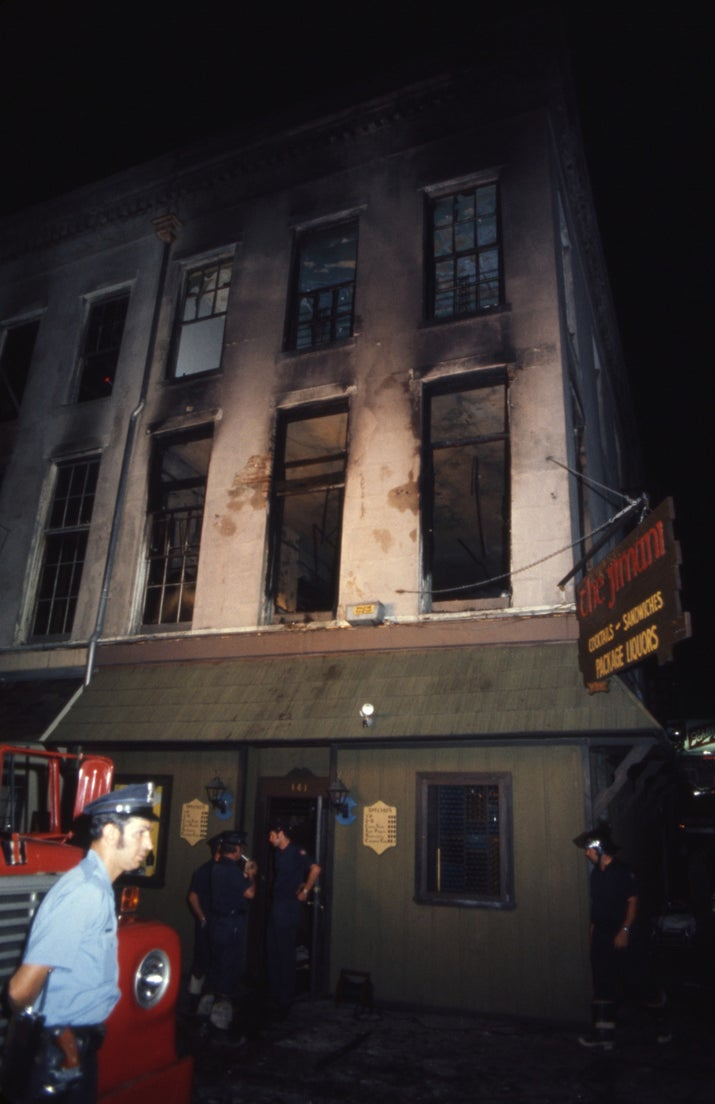 Firemen and rescue workers outside the remains of the Up Stairs Lounge.