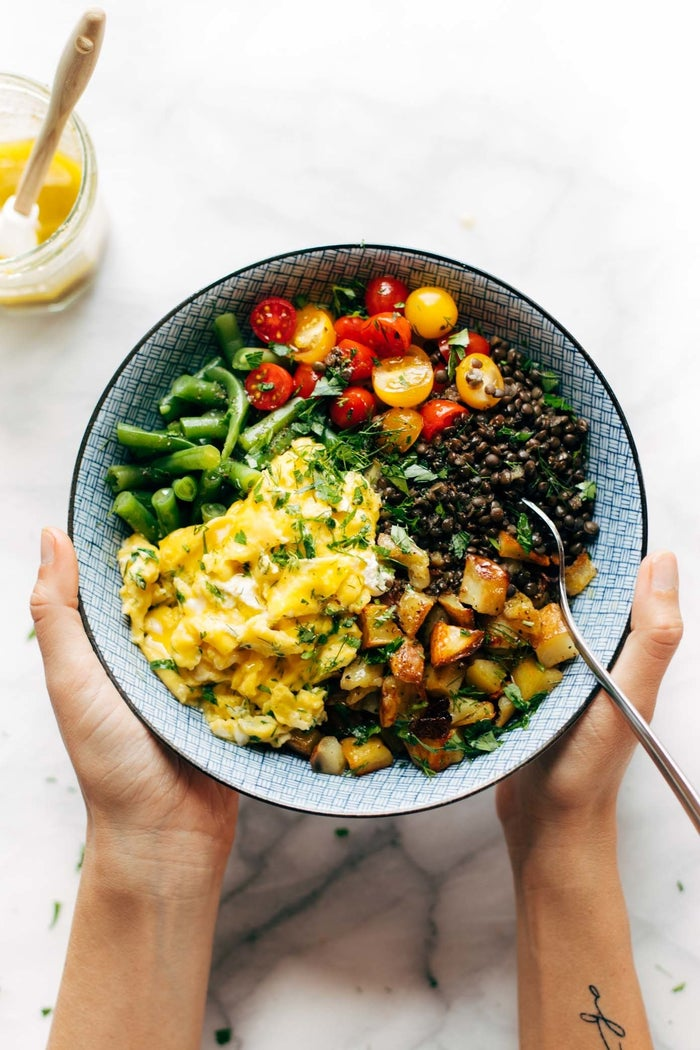 Honestly, who doesn't love a nourishing bowl that tastes as good as it looks? This one features lentils, eggs, potato, green beans, tomato, dill, and goats cheese, with an incredibly tasty dressing. Get the recipe here.