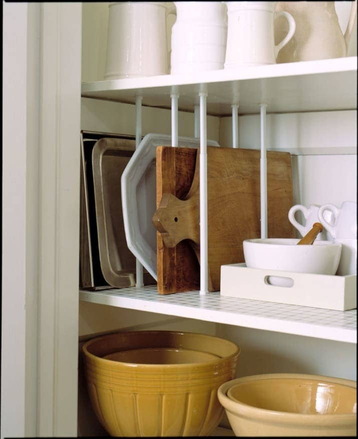 Just make sure to measure the height of your shelves! From Martha Stewart. Get a set of five tension rods that expand from about 12 inches to 20 inches on Amazon for $11.39 (three colors).