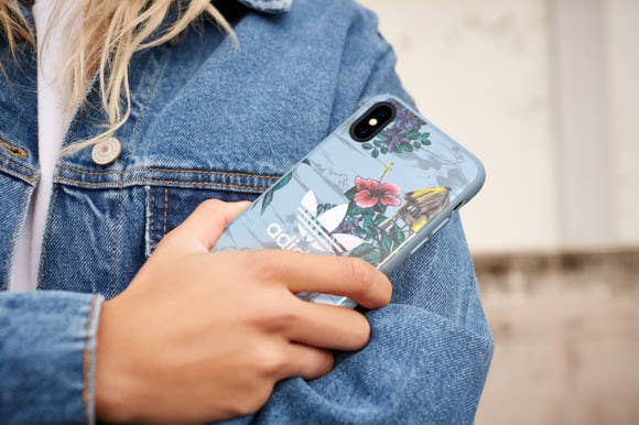 The true spirit of adidas Originals is brought to life in an array of cases for the iPhone. The new collection includes AOP Beach and Floral (pictured). These seasonal adidas Originals cases helps protect your phone from impact and wear and tear. It's made of ultra-light TPU that's impact-resistant for optimal protection for your device. The case features Floral and Island print for a stylish look and are available for iPhone 7/8(+) & X.