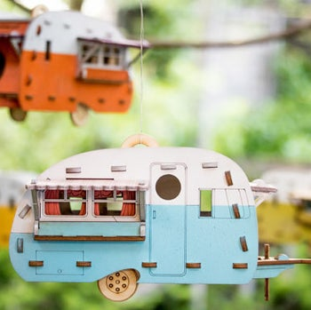 birdhouse assembled and hanging from tree