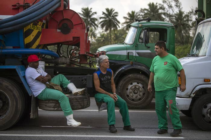 A depreciation in Brazil's currency, the real, together with increasing oil prices, is driving up fuel costs — angering the drivers, who've begun parking on major highways in protest.