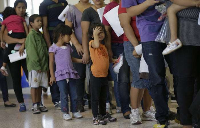 Immigrants stand in line for tickets at a bus station after they are released from a Customs and Border Protection processing facility in Texas.