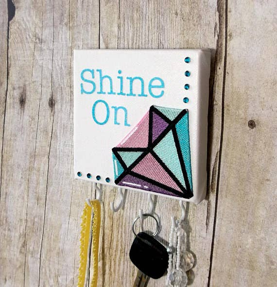 "You and your best friend always have each others' backs ~ through thick and thin! Remind her to ""shine on"" even when you're not together with this adorable diamond necklace holder from JustAddJewelry. It's the perfect mantra for her as she's running out the door to face the day!"