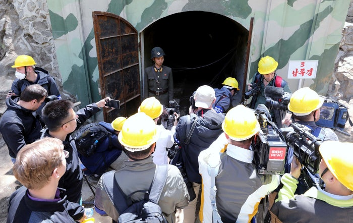 Journalists look around the third tunnel at Punggye-ri.
