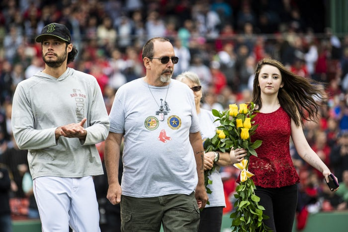 Joe Kelly, right, of the Boston Red Sox escorts a gold star family before a game against the Toronto Blue Jays on Monday.