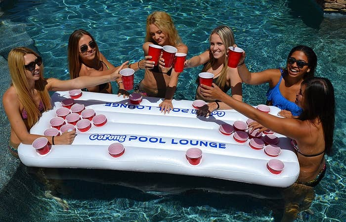 bcef372ed6446f A raft that'll allow you and your squad to enjoy some puhretty epic rounds  of beer pong in the pool — juice or water pong if you're under the age of  21, ...