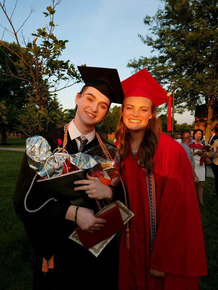 Holy Cross valedictorian Christian Bales with student council president Katherine Frantz outside of their graduation in Kentucky Friday.