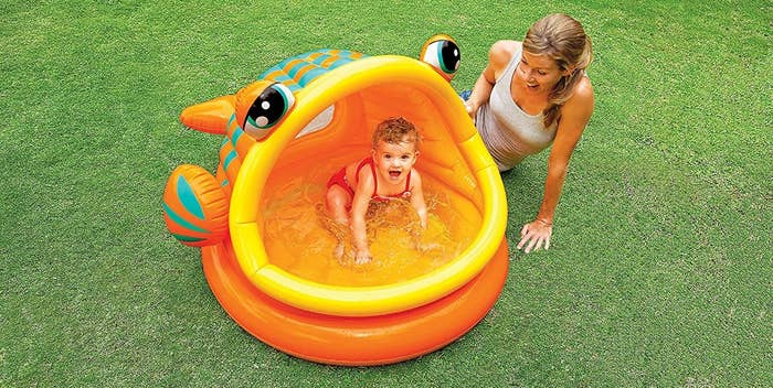 e2aeb726ca2034 An inflatable shaded pool that'll allow your little one who isn't quite  ready to swim in the big pool yet to enjoy a refreshing dip, while keeping  their ...