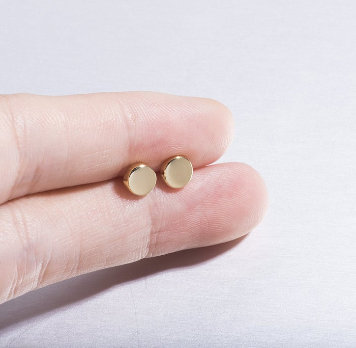 "Promising review: ""These are great minimalist earrings! They are light, but strong and have a good tone/color to them. The packaging was top-notch, too! The earrings were presented nicely in a cute gift box, and underneath the earrings were a small polishing cloth and baggie containing extra plastic backings to keep on hand."" —RebeccaGet them from Amazon for $15.50 (available in three finishes)."