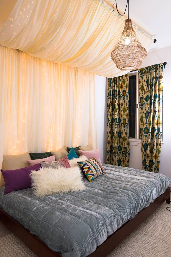 Hide The Lights Behind Sheer Curtains To Make Your Room A Little More Dreamy
