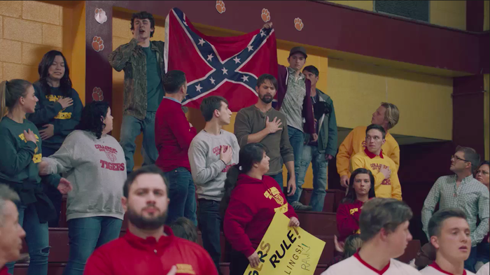 """You want to disrespect our flag, get off the court. Go back to where you came from,"" comes one yell from the crowd. The decision to add the Confederate flag, which is commonly associated with the values of the Confederacy (including being pro-slavery), is a strong statement from the series, as many have directly linked opposition to the protests with racism."