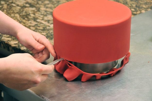 Put a little vegetable shortening on your knife when you go to cut off excess fondant so it doesn't stick while you cut.