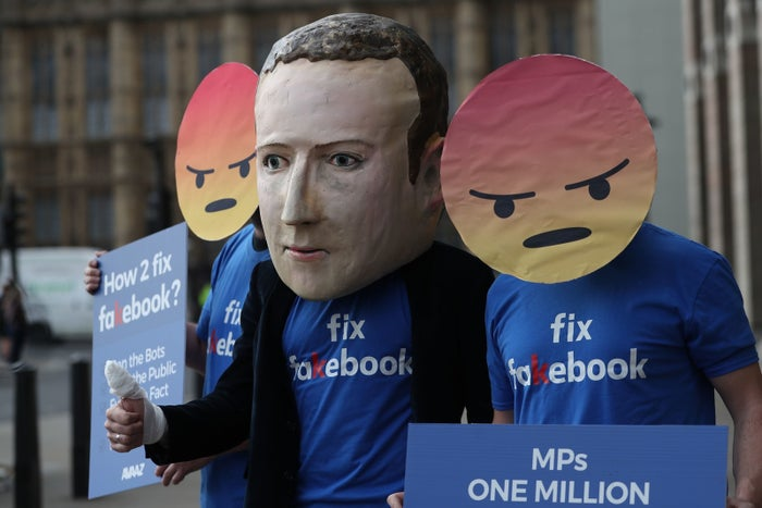Protestors demonstrate outside Portcullis House in London, where Facebook's Chief Technology Officer Mike Schroepfer faced questions, including some about employee Joseph Chancellor, from members of the UK parliament in April.