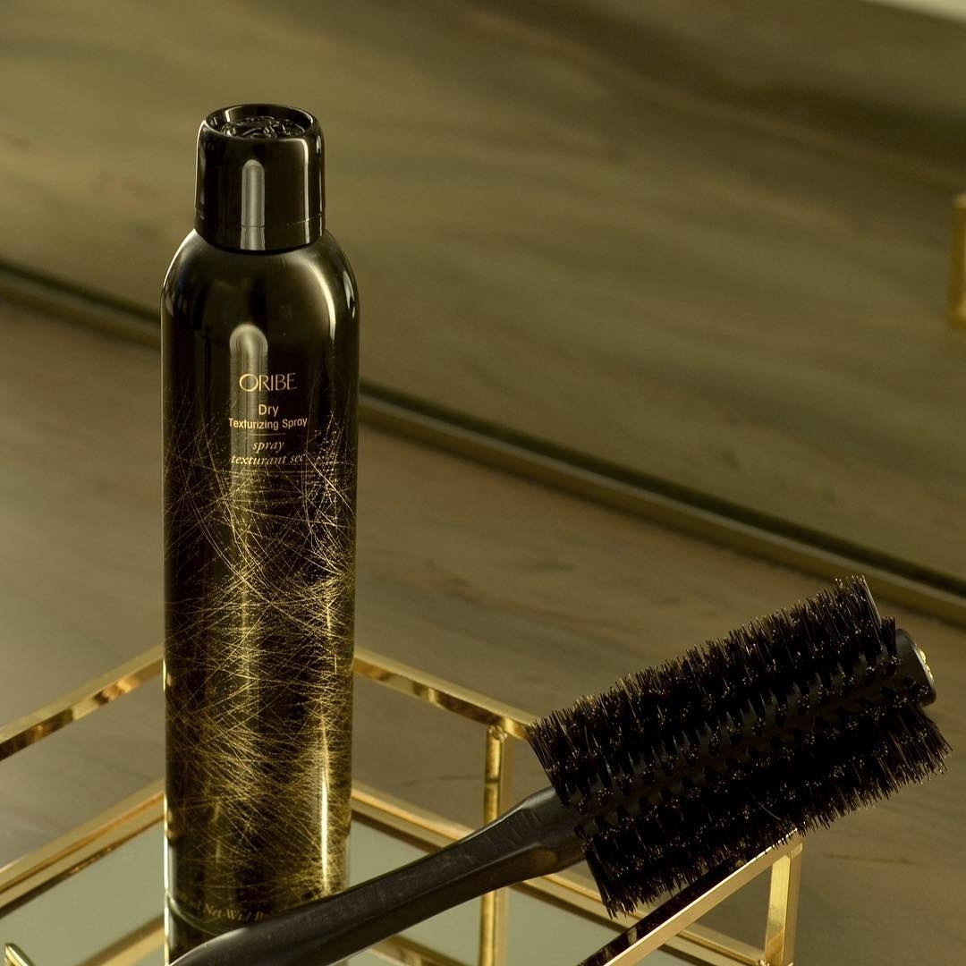 can of the hairspray styled with a brush