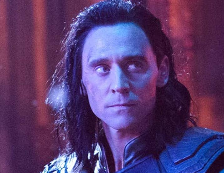 """Crystal: I know I'm not alone when I say Loki is weirdly very attractive. IDK, maybe it's not weird? Sure, he's a """"BAD GUY"""" (whatever), but the boy has got looks that could kill. Also, REALLY into the long dark hair — he's basically every '00s emo girl's dream. 9/10 Jenna: See, I feel weird because I'm NOT attracted to him and everyone else seems to be. I mean, I think Tom Hiddleston is incredibly handsome in real life, and I could watch him bite his lip all day. But as Loki I find him almost...repulsive? Like, the dark hair and brows do not suit him IMHO. Especially since I can't unsee that Tommy Wiseau meme. 3.5/10Thirst level: 6.25"""