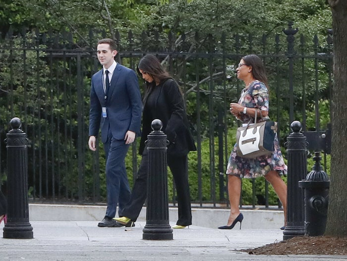 Kim Kardashian West (center) arrives at the security entrance of the White House on May 30, 2018.