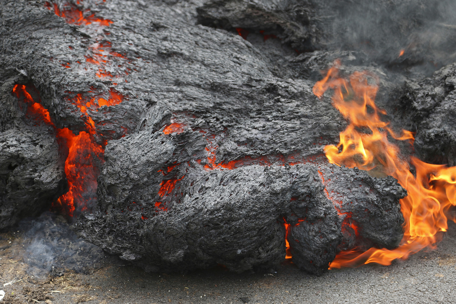 Lava burns across a road in Leilani Estates on May 5.