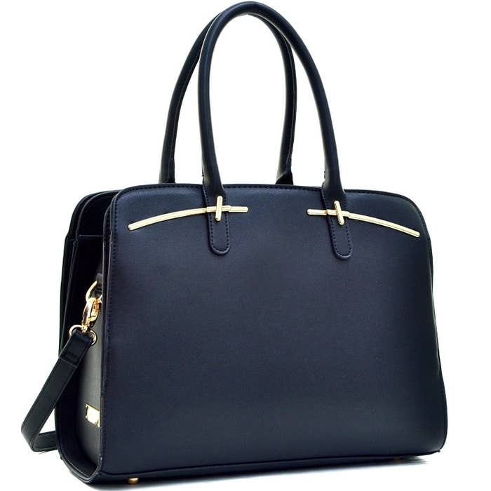 b668fd1f4e A faux leather satchel purse that opens up like an accordion so absolutely  no item is left without a proper place.