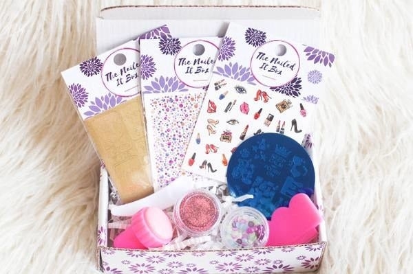 What you'll get: You'll always get a stamping plate that fits that box's ~theme~ and three sets of water decals. Besides those, you'll get one or two other items like a pack of rhinestones, caviar beads, glitter, tapes, foils, stickers, and sometimes even tools. Oh, and a set of easy-to-follow instructions, of course! You'll just have to provide the polish and top coat yourself. Price: $14.95+ per month, plus free shipping in the US.