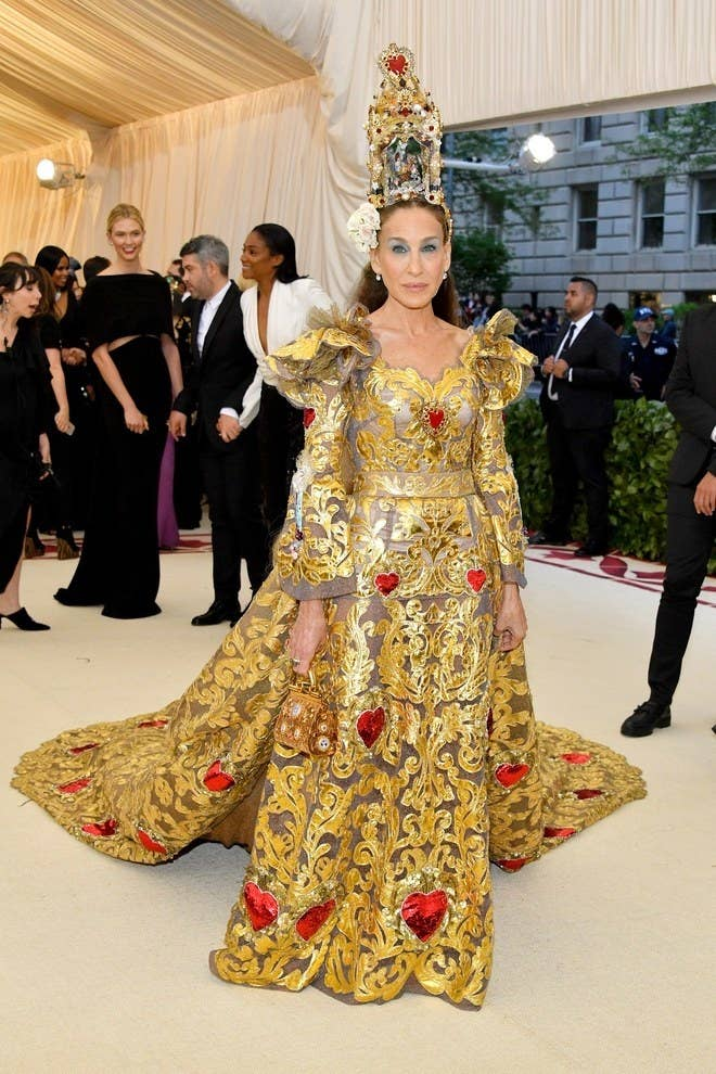Each year more than a few trends manifest, making them specifically Met Gala staples – two big ones are long trains and headpieces. No one does a hat like Sarah Jessica Parker. Together with GBF (gay best friend) Andy Cohen, she and her train of gold and ivory took to the stairs. In Dolce and Gabbana – a collection that was a sure thing for this theme, she accessorized with a hat that was also a cage.