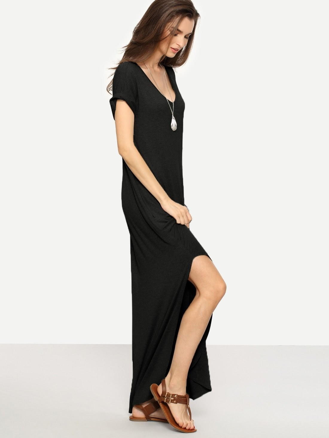 Model wearing the dress, which has short sleeves, a scoop neck, and a slit