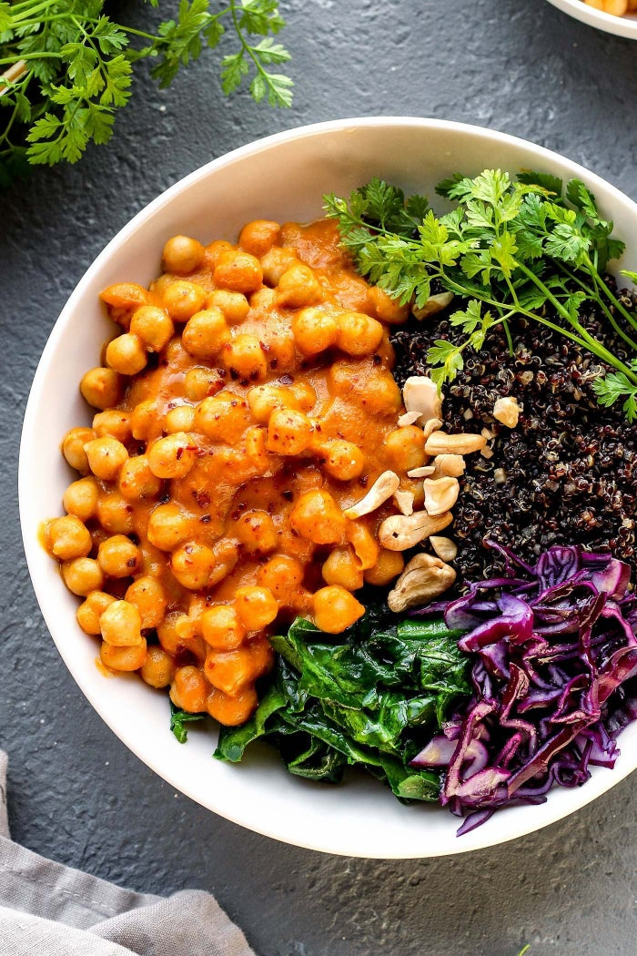 This colorful bowl is a vegan dream. The cabbage, spinach, carrots, and bell peppers basically make this a salad, but ten times more delicious. The chickpeas, quinoa, and cashews will give you all the protein you need to feel full and energized. Get the recipe here.
