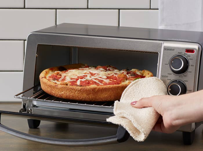 """This handy gadget has five settings: bake, bage, broil, toast, and keep warm, and it can fit up to a 9-inch pizza — because frozen pizza is basically study fuel.Price: $20.88 (originally $24.96; available in two colors).Promising review: """"I'm happy with my purchase. I needed a small toaster/broiler oven for my micro home and this well designed sturdy little appliance fits the bill. It is just the right size for cooking meals for one or two people. It's lightweight and compact, and it does everything a larger oven does, but takes up only a fraction pf the space. The timer can be set for up to 30 minutes or set to 'Stay On.' There are two levels for the racks. Easy clean up w/the crumb tray."""" —Walmart Customer"""