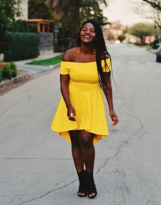 A reviewer wearing the slightly high-low dress in yellow