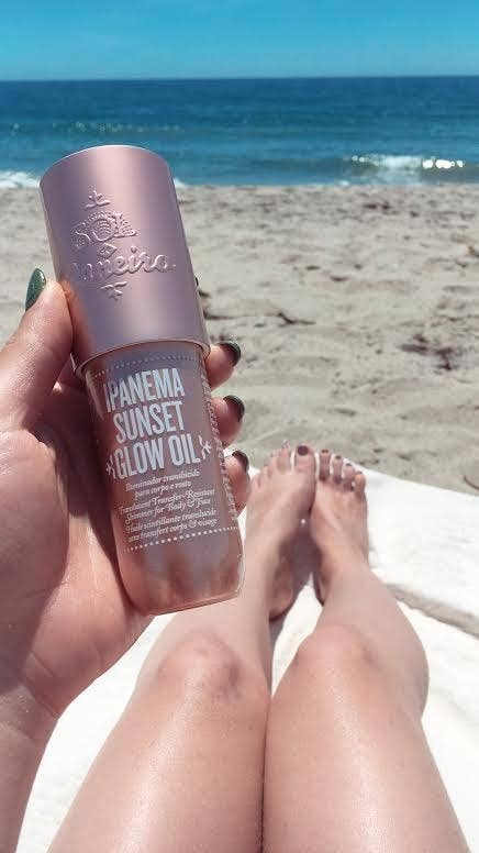 """""""I've always thought I was too practical for something that's essentially a highlight oil but let me tell you, this Sol de Janeiro Ipanema Sunset Glow Oil is my new summer staple. Summer is my favorite season, but always being slathered in sunscreen means I'm either sweaty, sticky, stinky, or usually a combination of all three. This glow oil made me feel like I WAS the goddess of summer incarnate — I was radiant, moisturized, and smelled divine. The smell is intoxicating; it's like opening a portal to the beach cabana vacation of your dreams, but not in an overpowering way. The radiance it gave me was wonderful and the glitter is extremely fine, more like a subtle body highlight than a body glitter. It didn't even rub off on my clothes! (Still, I would only put it on the parts of my body that were showing rather than use it all over like a lotion.) I could see this really amping up a night look, or even just giving that extra oomph on oppressively hot summer days. If you are using it during the day I'd layer it over sunscreen just for that extra protection. It's $35 for a decently sized bottle and comes in two colors; a champagne-y beige and a rich coppery bronze. These Sol de Janeiro Glow Oils are technically limited edition, and I've already ordered two extra bottles because I refuse to be without it."""" —Claire de Louraille Get it from Sephora for $35 (available in two shades)."""