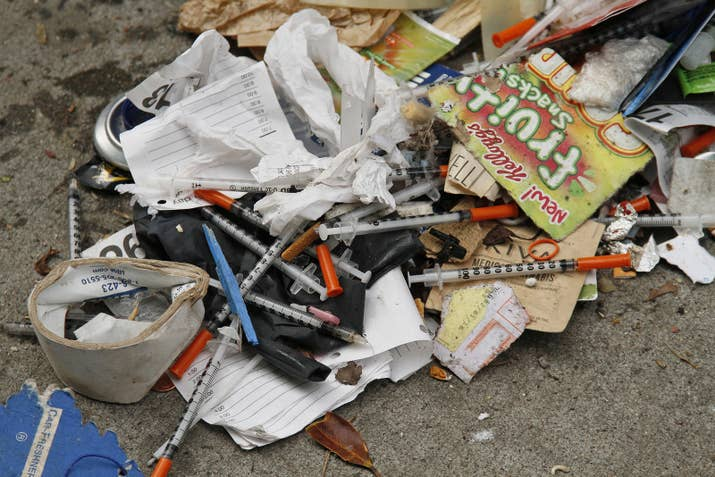 Syringes are scattered in the remains of a tent city along Division Street in San Francisco.