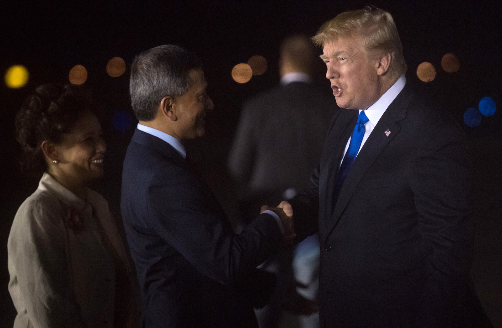 Donald Trump is welcomed by Singapore's Foreign Minister Vivian Balakrishnan upon his arrival Sunday for his historic meeting with Kim Jung Un.